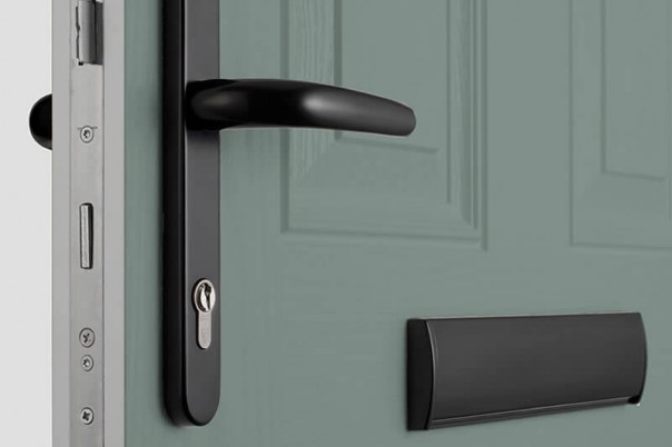 Modern composite door with black handle and letterbox