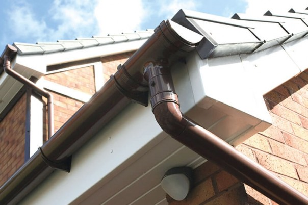 Brown roof guttering and down pipe